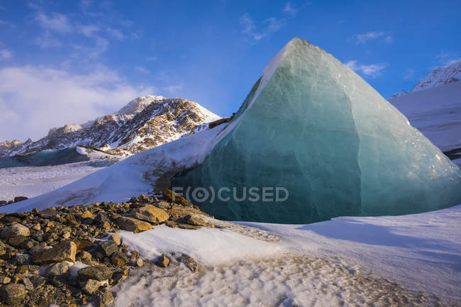 Piece of glacier ice juts out of rocky — Stock Photo