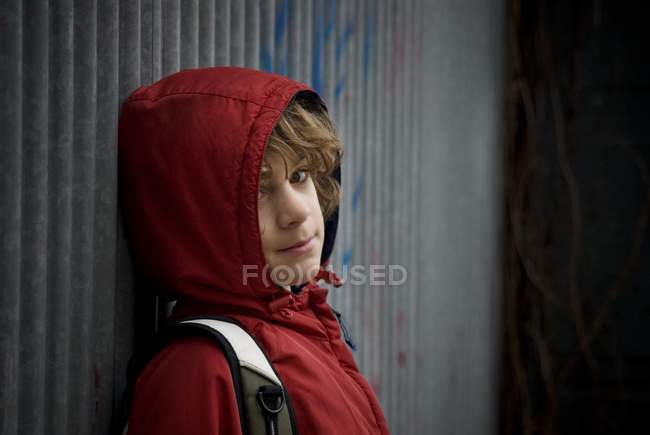 Teenage Boy; Boy Wearing A Hooded Jacket and looking at camera — Stock Photo