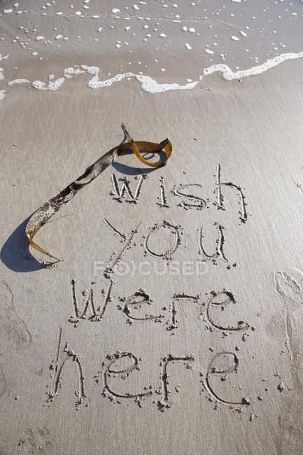 Scrivere nella sabbia, Low Newton Beach — Foto stock