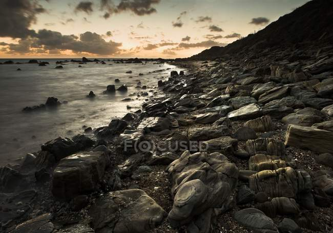 Sunset Over Water At Shoreline — Stock Photo