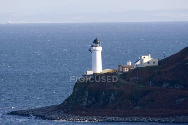 Lighthouse On plumb Coast — Stock Photo