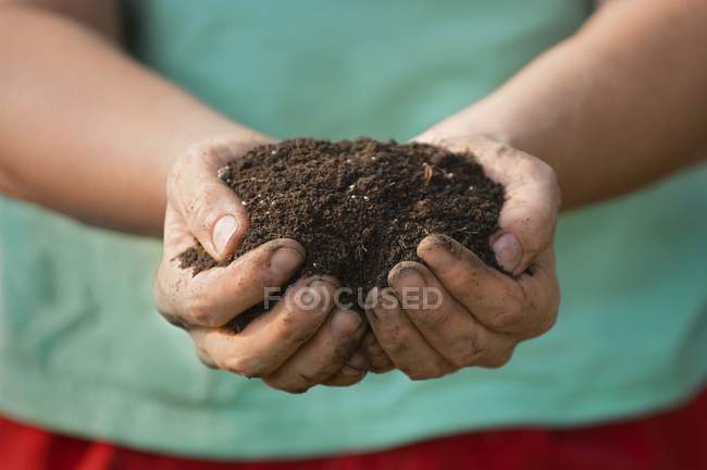 Midsection of Handful Of Soil  during daytime — Stock Photo