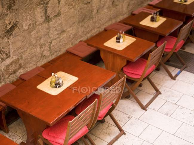 High angle view of tables and chairs in loft cafe — Stock Photo