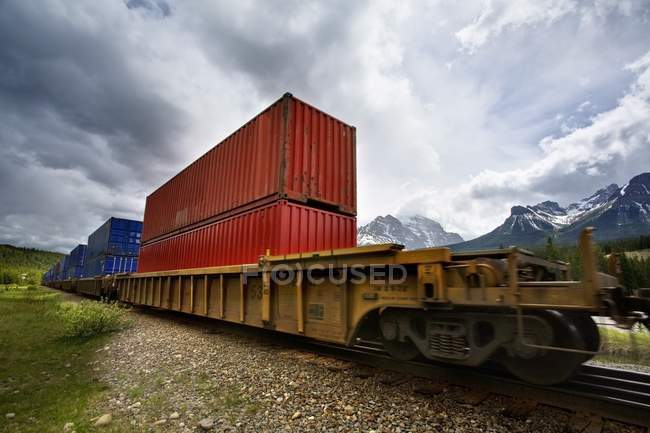 Train in front of mountains — Stock Photo