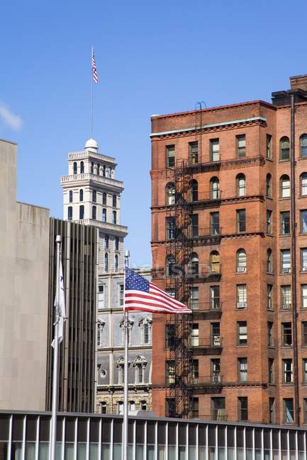 American Flag surrounded by buildings — Stock Photo