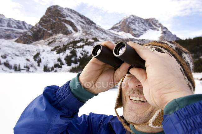 Man Looking Through Binoculars — Stock Photo