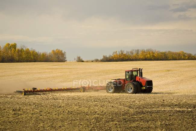 Tractor ploughing field — Stock Photo