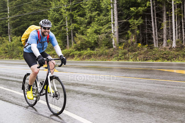 Front view of Cyclist Riding Through Pacific Rim National Park; Vancouver, British Columbia, Canada — Stock Photo