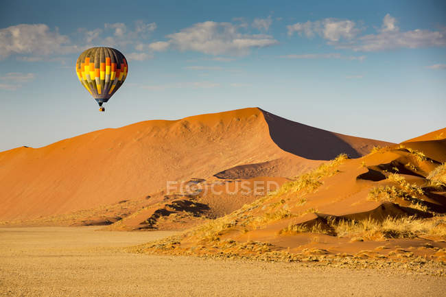 Hot air balloon ride over the red sand dunes of Sossusvlei in Namibia; Sossusvlei, Hardap Region, Namibia — Stock Photo