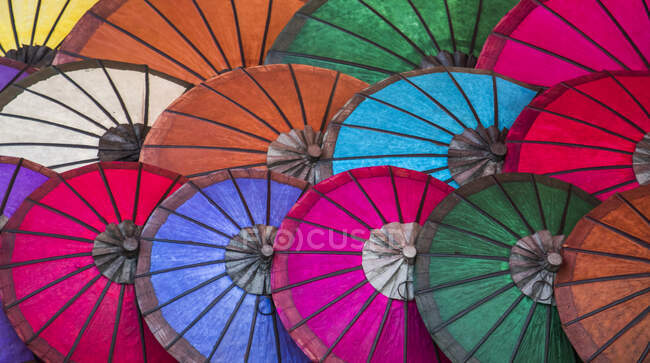 Bright coloured paper umbrellas for sale at the night market; Luang Prabang, Luang Prabang, Laos — Stock Photo