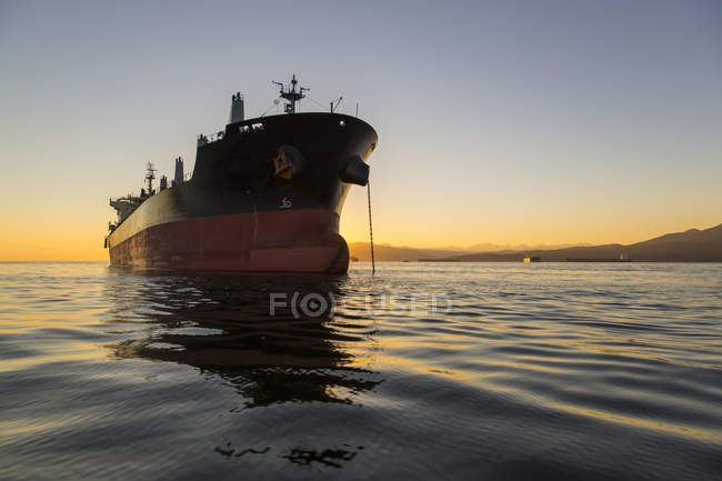 A large ship anchored in the tranquil Pacific Ocean off the coast of Vancouver; Vancouver, British Columbia, Canada — Stock Photo