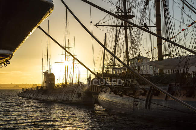 Ship and sailboat in the harbour at sunset; San Diego, California, United States of America — Stock Photo
