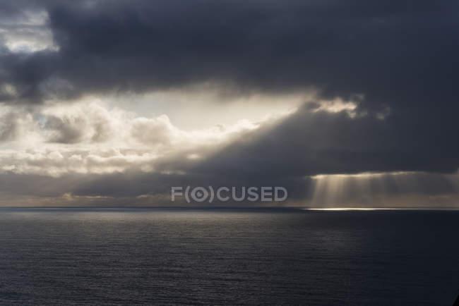 Sunlight breaks through the clouds off the coast of Oregon; Manzanita, Oregon, United States of America — Stock Photo