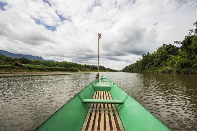 Boat on the Nam Khan river; Luang Prabang, Laos — Stock Photo