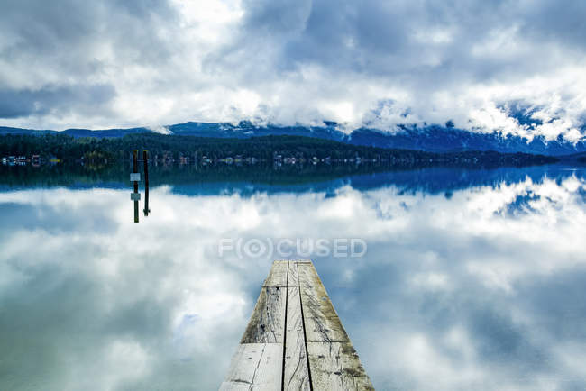 Clouds reflected in the tranquil ocean water off the coast of Tofino, Vancouver Island; Tofino, British Columbia, Canada — Stock Photo