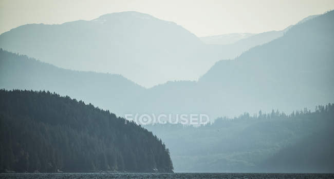 Moody landscape of mist over the Great Bear Rainforest; Hartley Bay, British Columbia, Canada — Stock Photo