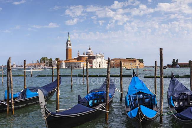 Gondolas in Venice, moored opposite San Giorgio Maggiore; Venice, Italy — Stock Photo