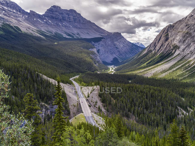 Road through the rugged Canadian Rocky Mountains; Improvement District No. 9, Alberta, Canada — Stock Photo