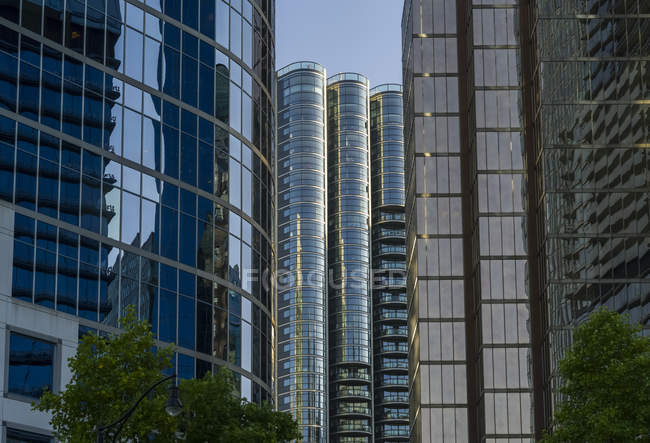 Skyscraper office buildings and condominiums with glass facades reflecting the blue sky and adjacent buildings; Vancouver, British Columbia, Canada — Stock Photo