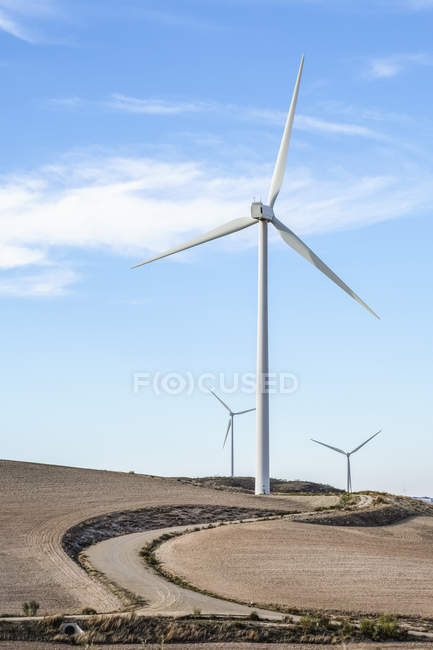 Wind turbines with maintenance access road; Campillos, Malaga, Andalucia, Spain — Stock Photo