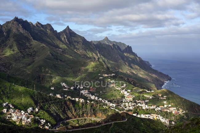 Village of Taganana on coast of Tenerife, Spain with rugged mountains of Anaga beyond; Taganana, Tenerife, Spain — Stock Photo