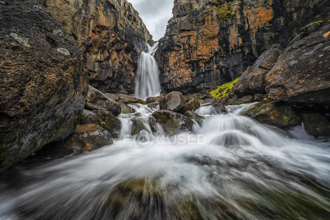 Waterfall along the road on the West Fjords; West Fjords, Iceland - foto de stock