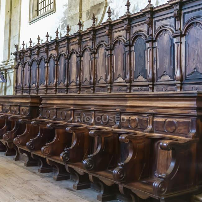 Wooden seating at Monastery of Santa Maria de Salzedas; Portugal — Stock Photo