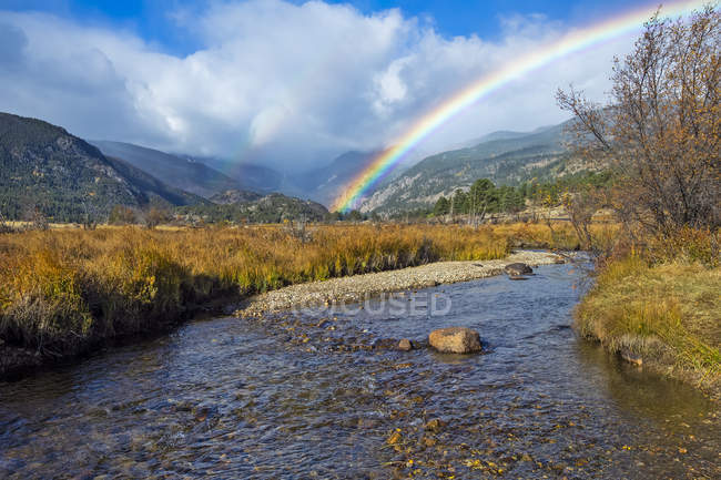 Double rainbow over a river and mountains, Denver, Colorado, United States of America — стокове фото