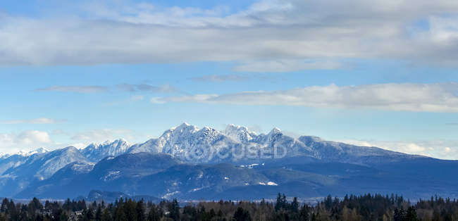 View of British Columbia Coastal mountain range from Surrey; British Columbia, Canada — Stock Photo