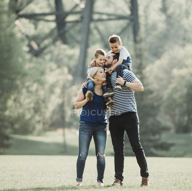 A family with young children playing in a park; Edmonton, Alberta, Canada — Stock Photo