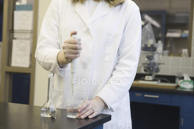 Cropped view of female scientist working in a laboratory — Stock Photo