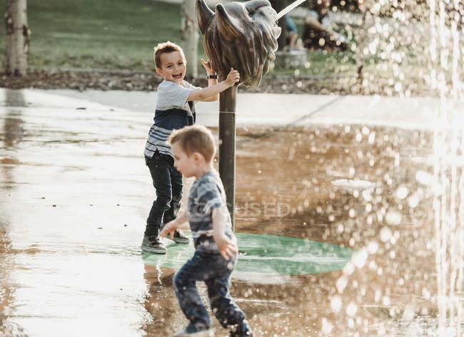 Young boys at a spray park; Edmonton, Alberta, Canada — Stock Photo