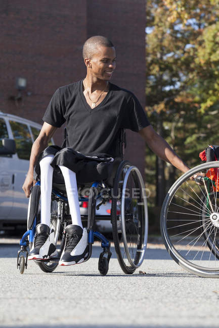 Man who had Spinal Meningitis in wheelchair entering his accessible vehicle — Stock Photo