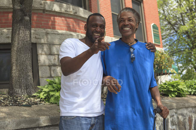 Man with Traumatic Brain Injury with cane enjoying his friend — Stock Photo