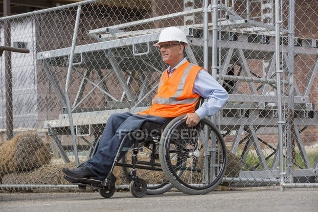 Project engineer with a Spinal Cord Injury in a wheelchair at job site — Stock Photo