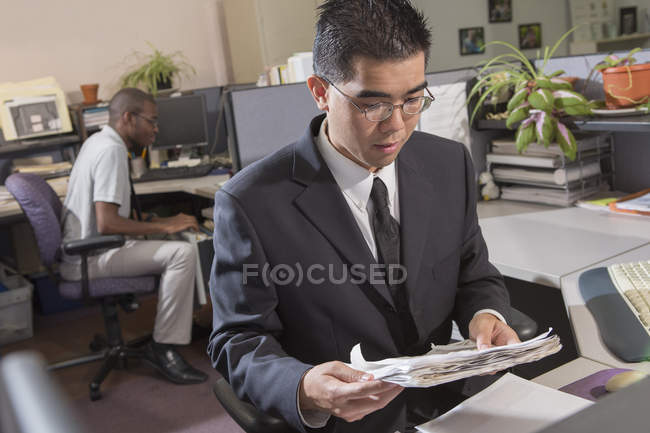 Asian man with Autism working in office — Stock Photo