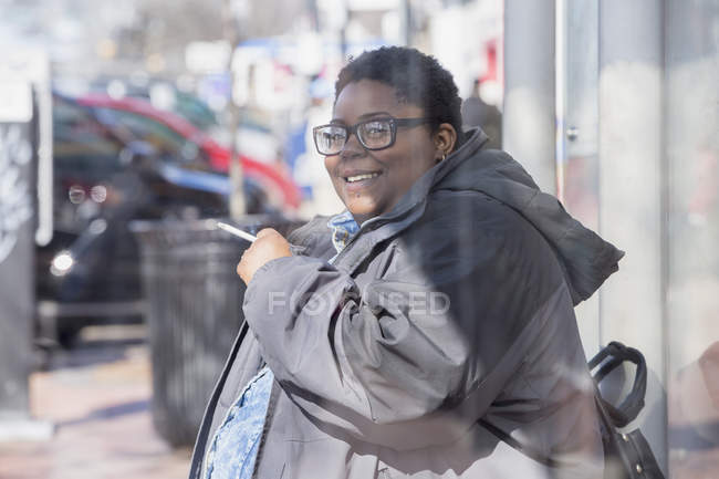 Woman with bipolar disorder smoking a cigarette — Stock Photo