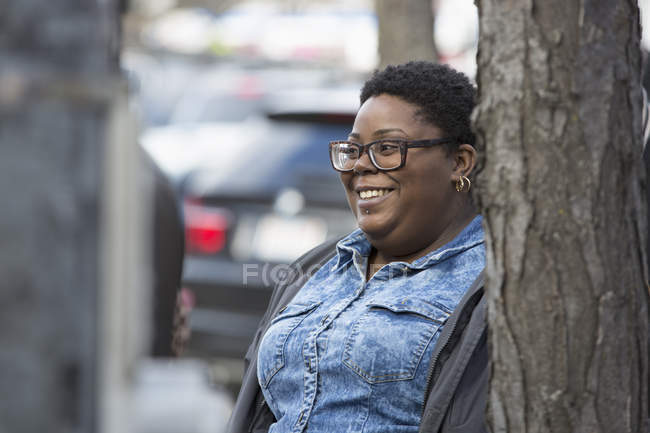 Portrait of a woman with bipolar disorder at city street — Stock Photo