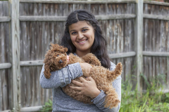 Teen with Autism and her pet dog — Stock Photo