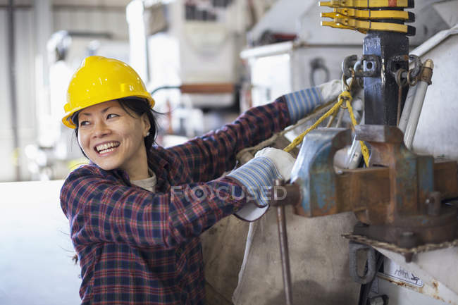 Female power engineer securing equipment on bucket truck — Stock Photo