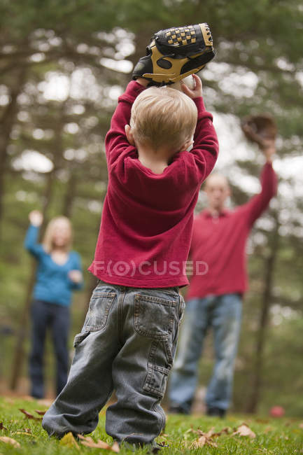 Boy playing baseball with his parents and using sign language to communicate — Stock Photo