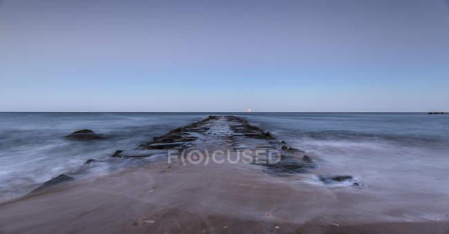Moonrise over abandoned pier, Rhode Island — Photo de stock