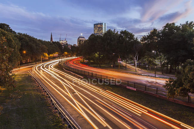 Traffic on the road in a city, Storrow Drive, John Hancock Tower, Boston, Massachusetts, USA — Stock Photo