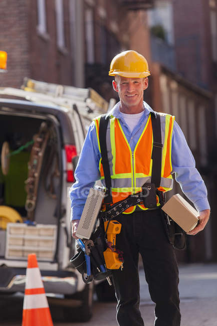 Cable installer with cable boxes from truck for installation — Stock Photo