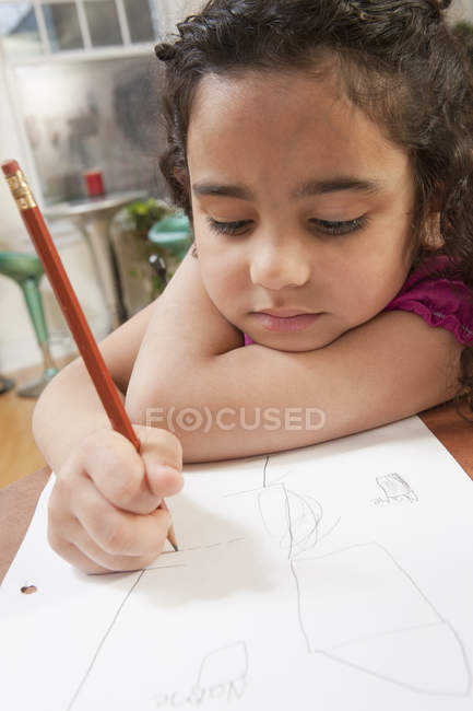 Close-up of a Hispanic girl drawing pictures — Stock Photo