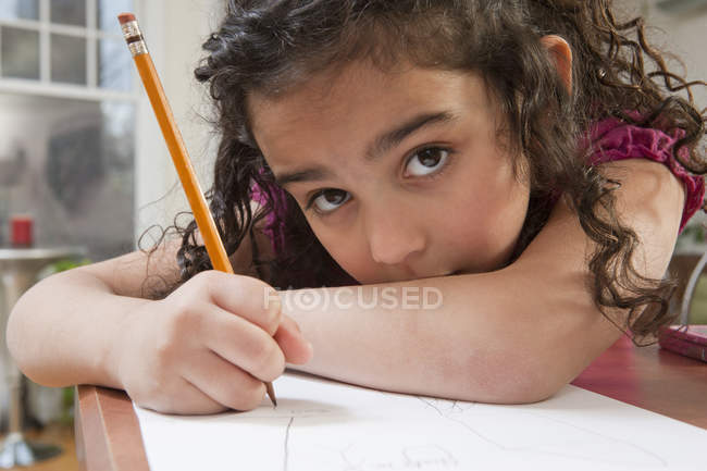 Portrait of a Hispanic girl drawing pictures — Stock Photo