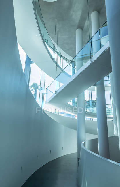 Modern indoor architecture of a corridor with curved white walls, pillars and glass; Lugano, Ticino, Switzerland — Stock Photo