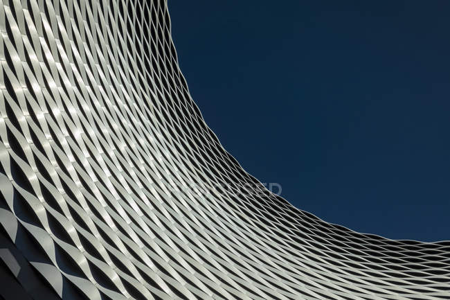 Low angle view of a patterned outdoor building facade with blue sky, Messe Basel Exhibition Centre; Basel, Basel Stadt, Switzerland — Stock Photo