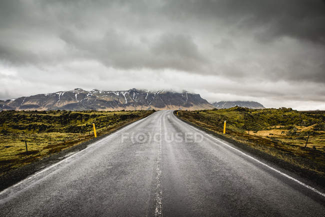 Scenic view of Isolated road surrounded by tundra; Iceland — Stock Photo