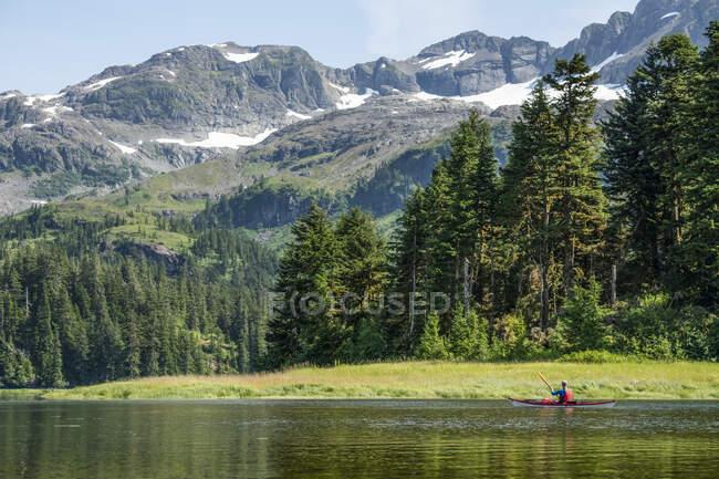 Kayaker paddling in Prince William Sound; Alaska, United States of America — Stock Photo